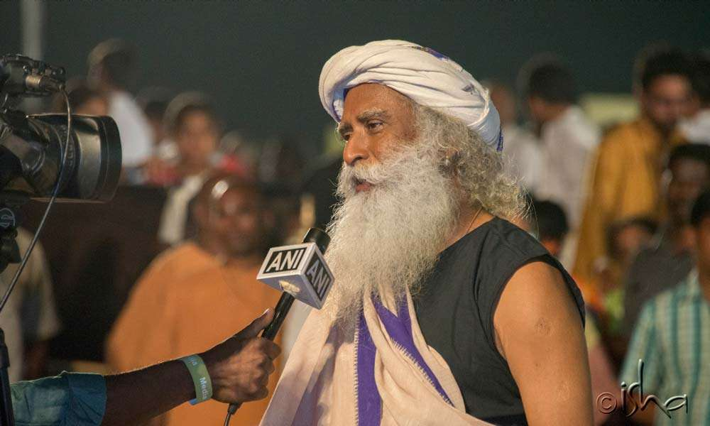 Sadhguru speaking to a news channel. The event was telecast by over 75 TV channels.