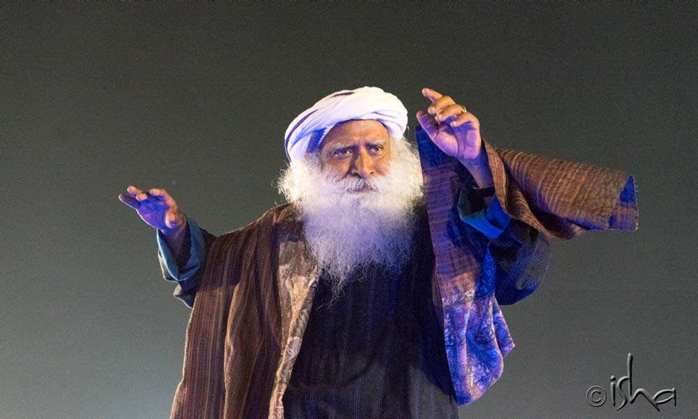 Sadhguru striking a spectacular pose to keep everyone awake and alive throughout the night