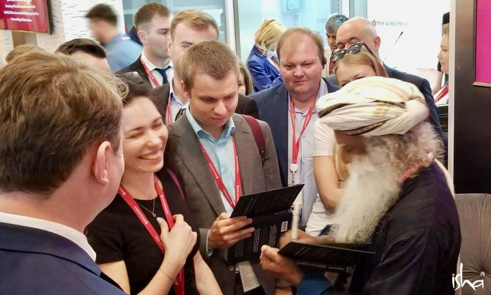 Sadhguru signing the Russian edition of the Inner Engineering Book in Moscow, June 2018