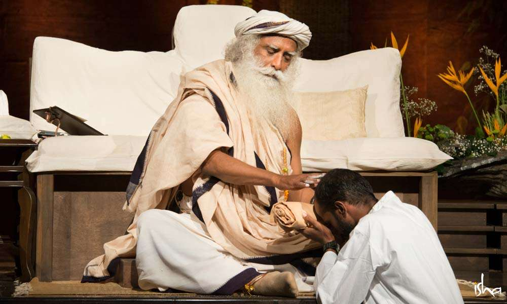 Guru Purnima Images | Sadhguru blessing a Devotee with Vibhuti