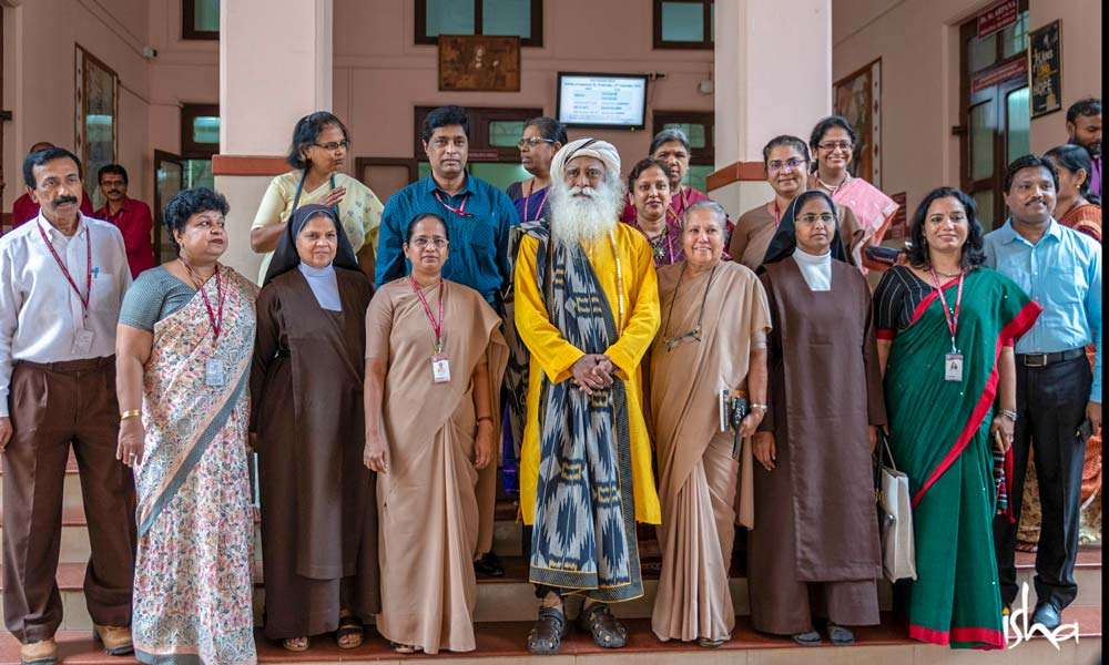 Sadhguru with the Principal and faculty of Mount Carmel College, Bengaluru