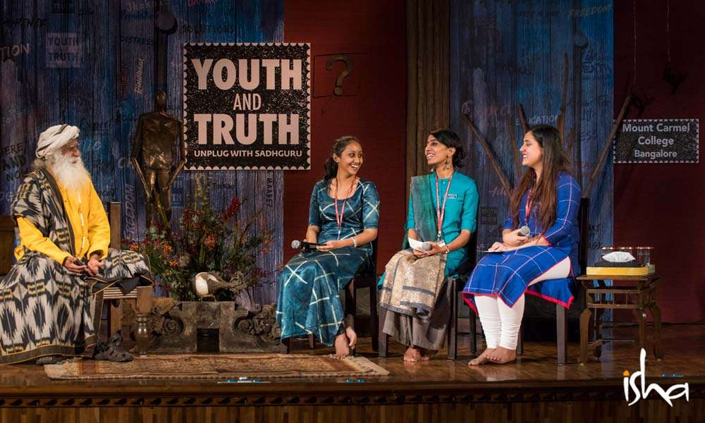 The moderators of Mount Carmel College, asking questions to Sadhguru