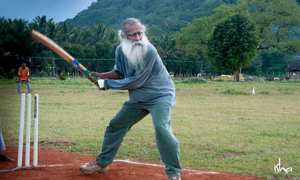 Sadhguru playing cricket at Isha Yoga Center