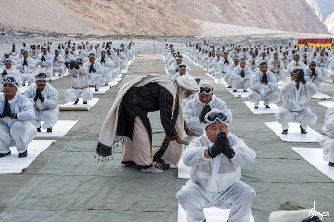 Sadhguru corrects a BSF soldier's posture during a Yoga session conducted for BSF soldiers at Siachen