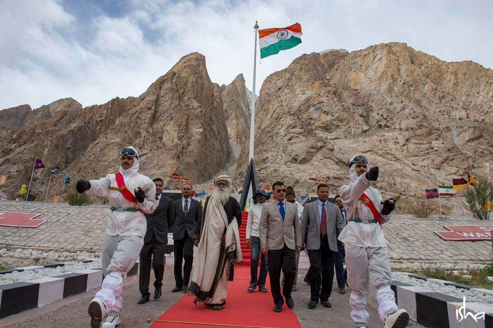 Sadhguru walking with the Guard of Honor at the BSF basecamp at Siachen