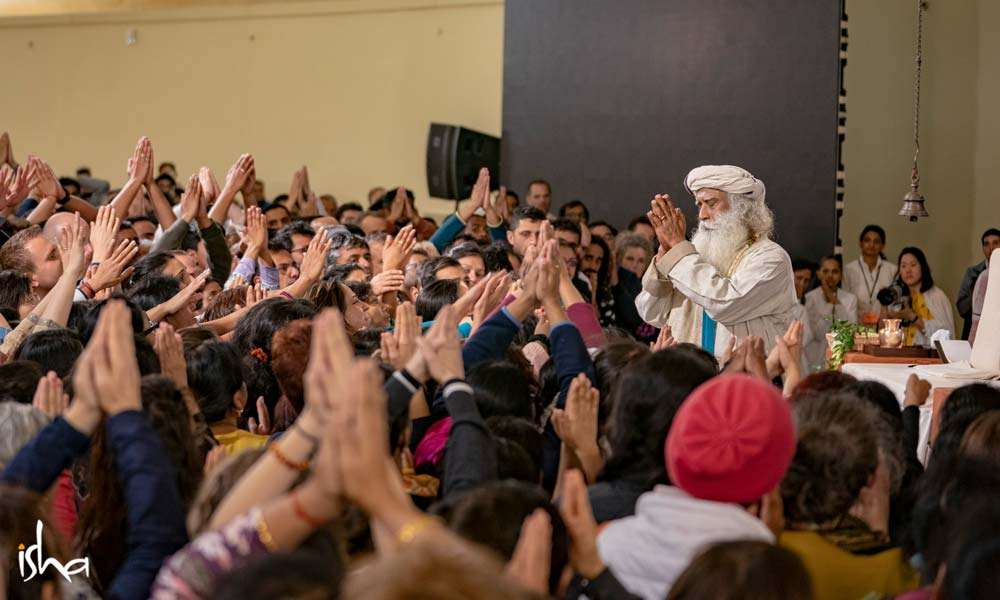 Sadhguru surrounded by the Bhava Spandana program participants at Isha Institute of Inner Sciences, TN, USA  | One Mega Life