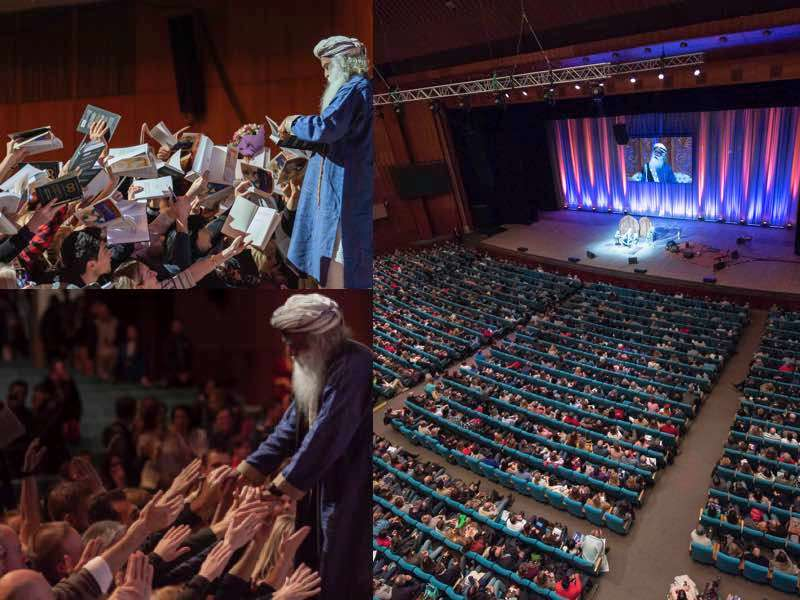 Sadhguru addressing a public talk and signing Inner Engineering book at an auditorium in Kiev, Ukraine | One Mega Life