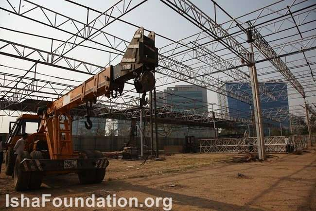 Temporary hall being constructed with cranes