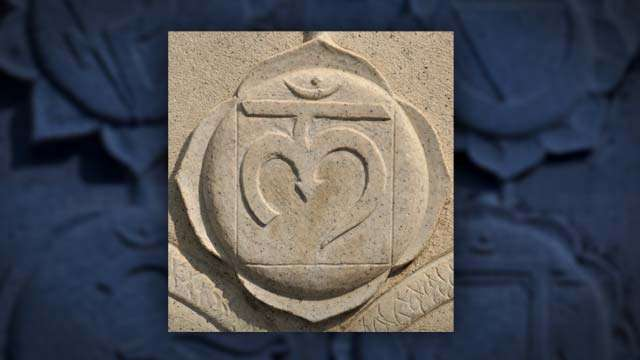 The symbol of Muladhara Chakra as carved on Dhyanalinga Sarva Dharma Stambha | Muladhara Chakra: Why It's The Most important Chakra