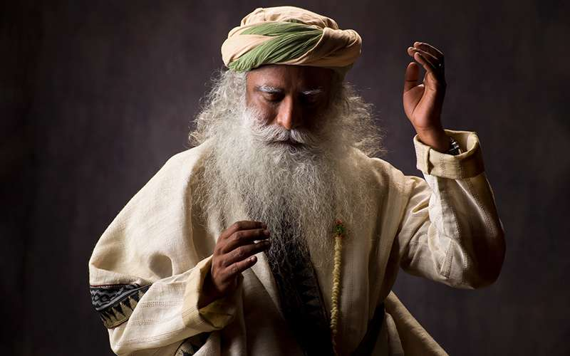quotes deep - sadhguru explores the meaning of karma defining it as a certain amount of information