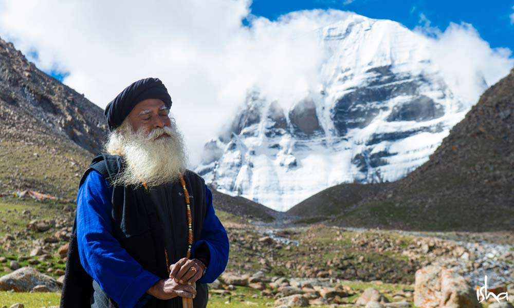 Sadhguru with eyes closed, stands at the foot of the Mount Kailash | Intoxicating Kailash and Manasarovar