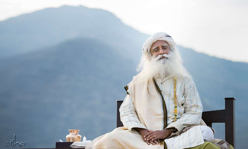 Sadhguru with eyes closed against the backdrop of Nilgiri Mountains | Stable like a Mountain