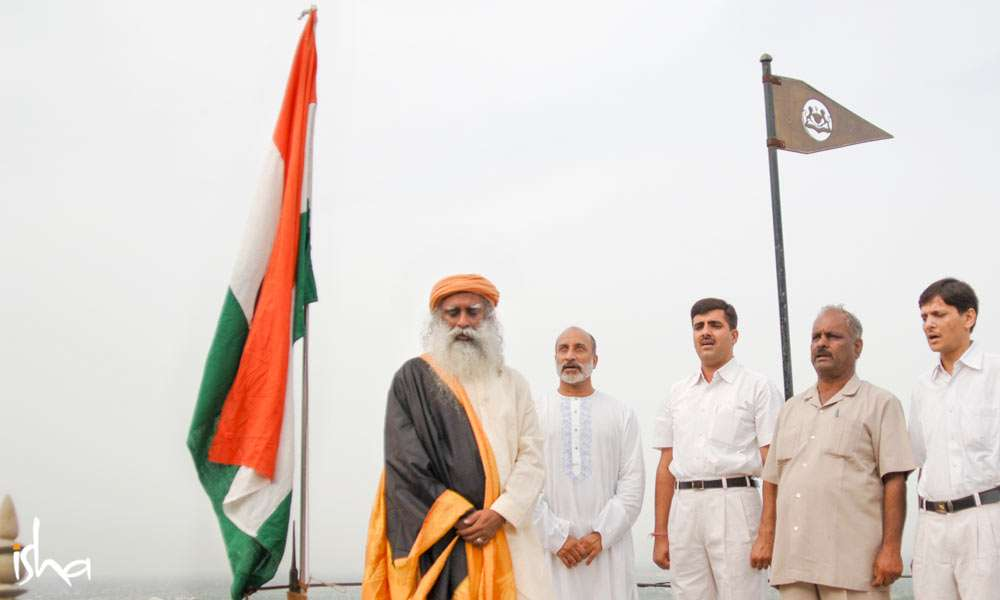 Sadhguru stands before the Indian flag with eyes closed | Should We Stand Up for the National Anthem?