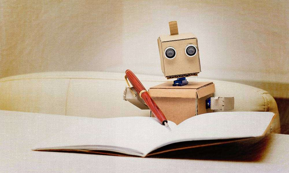 Cardboard Robot holding a fountain pen and notebook | Will Technology of the Future Become Boon or Bane?