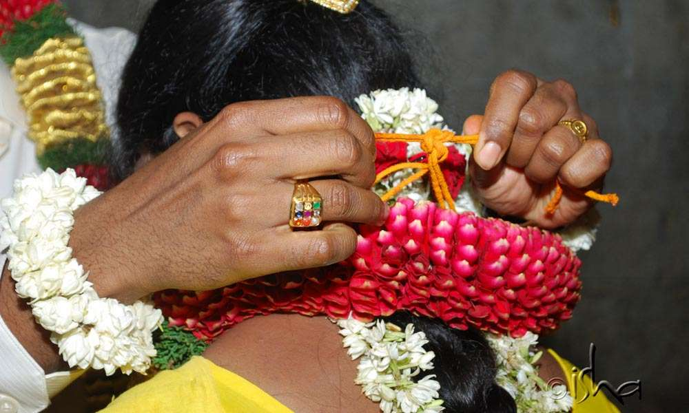 The groom tying the Mangalasutra to his bride; wedding at Linga Bhairavi | What Love Is and What Love Isn't