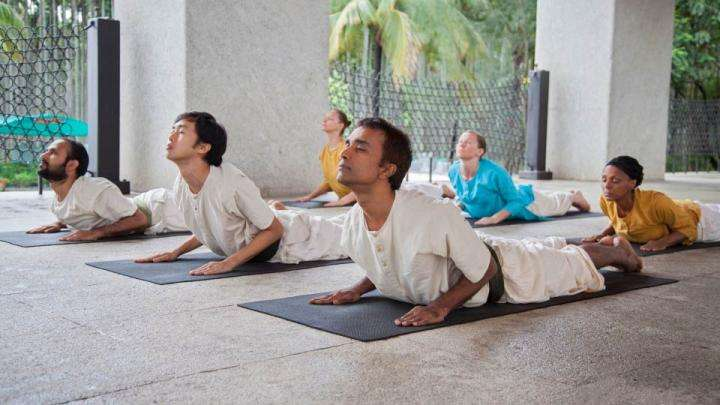 Isha Hatha Yoga participants doing Surya Namaskar