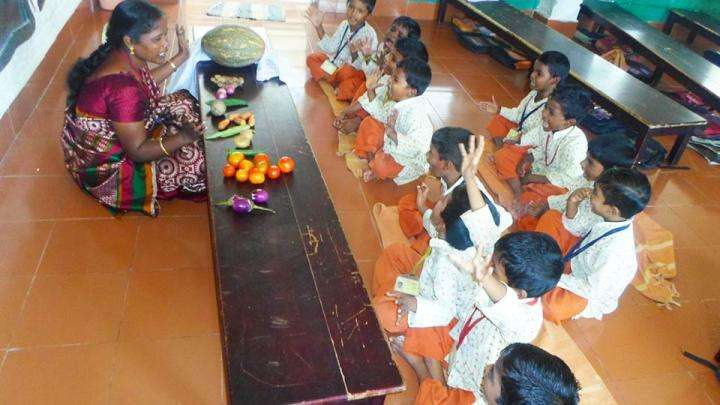Isha Vidhya students playing 'Missing Vegetables' game