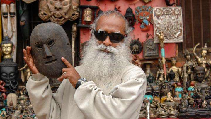 Sadhguru with a wooden mask in Nepal - Creating your personality at will