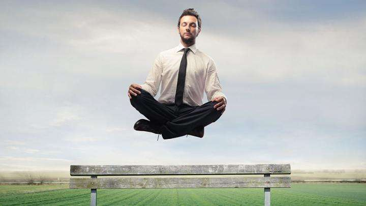 Office guy floating in meditation - No Need to Balance Spirituality and Materialism