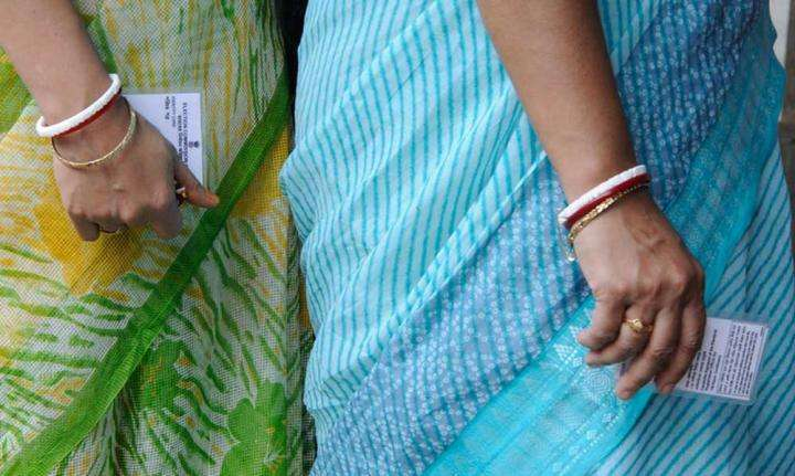 Women in queue holding their voter id's | Whom to Vote for in 2019? - Sadhguru Speaks
