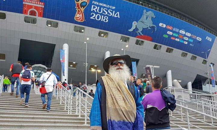 Sadhguru standing before the entrance to the St. Petersburg stadium, Russia to watch the FIFA World Cup 2018 semi-final between France and Belgium | Peak Intensity at the FIFA World Cup 2018