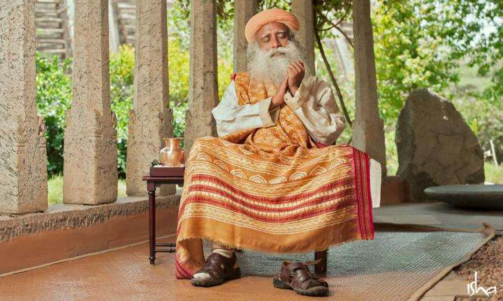 Sadhguru sitting on a chair with his eyes closed | Why Do You Sit in a Particular Way, Sadhguru?