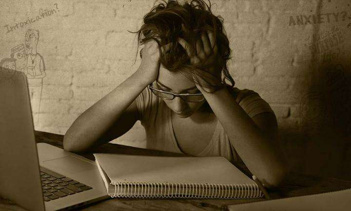 Girl student frustrated with studying, holding her head | Why Does My Education Seem Pointless?