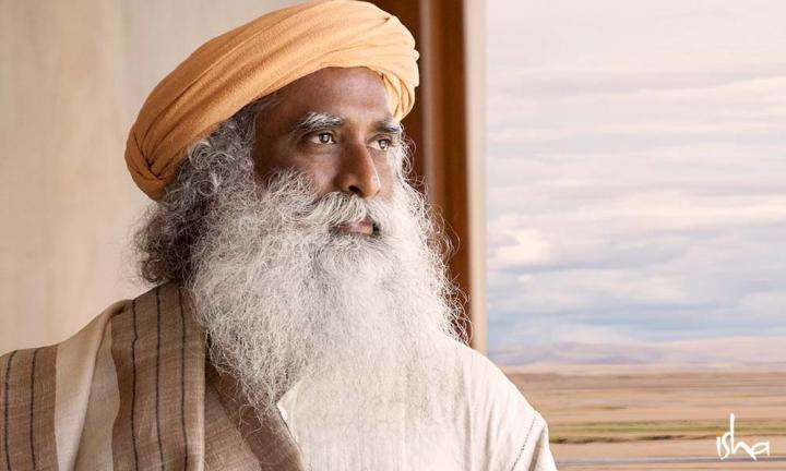 Sadhguru looking out a window | Success not a Conclusion