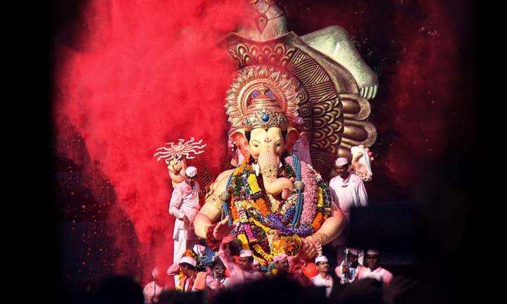 Big idol of Ganesh taken in a procession to be immersed into the ocean | The Symbolism of Ganesh Chaturthi